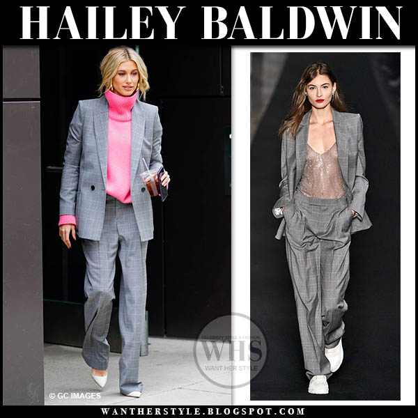 Hailey Baldwin in grey plaid blazer, pink sweater, grey plaid trousers and white pumps fashion week outfits february 2019