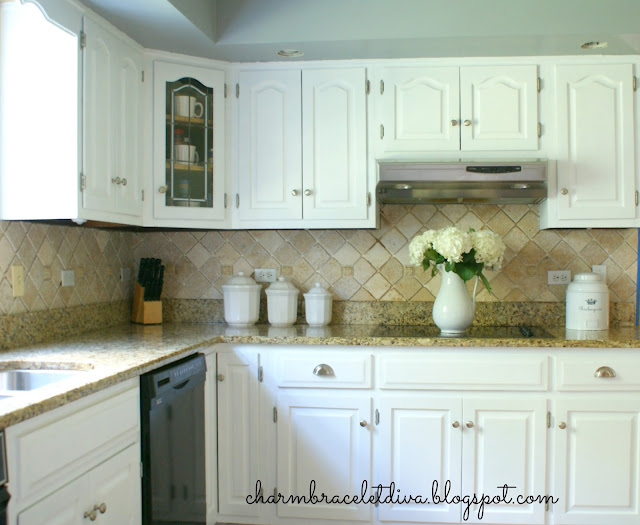 white farmhouse kitchen cabinets with brushed nickel knobs and cup pulls