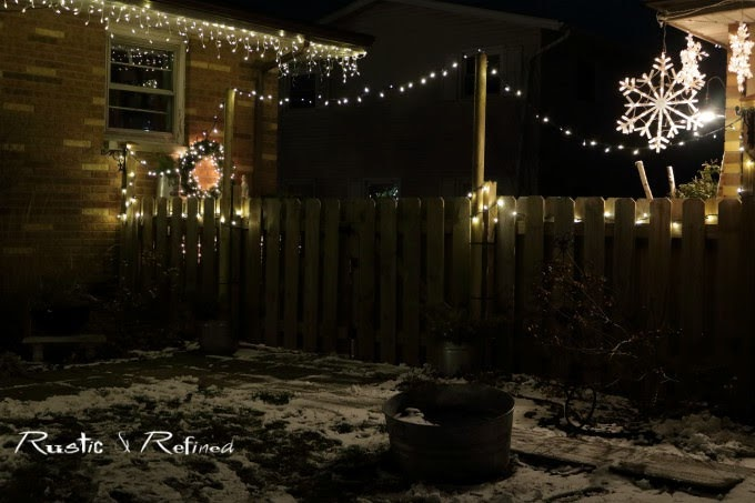 Decorating our home outside with christmas lights and gorgeous containers filled with live plants and christmas decor.