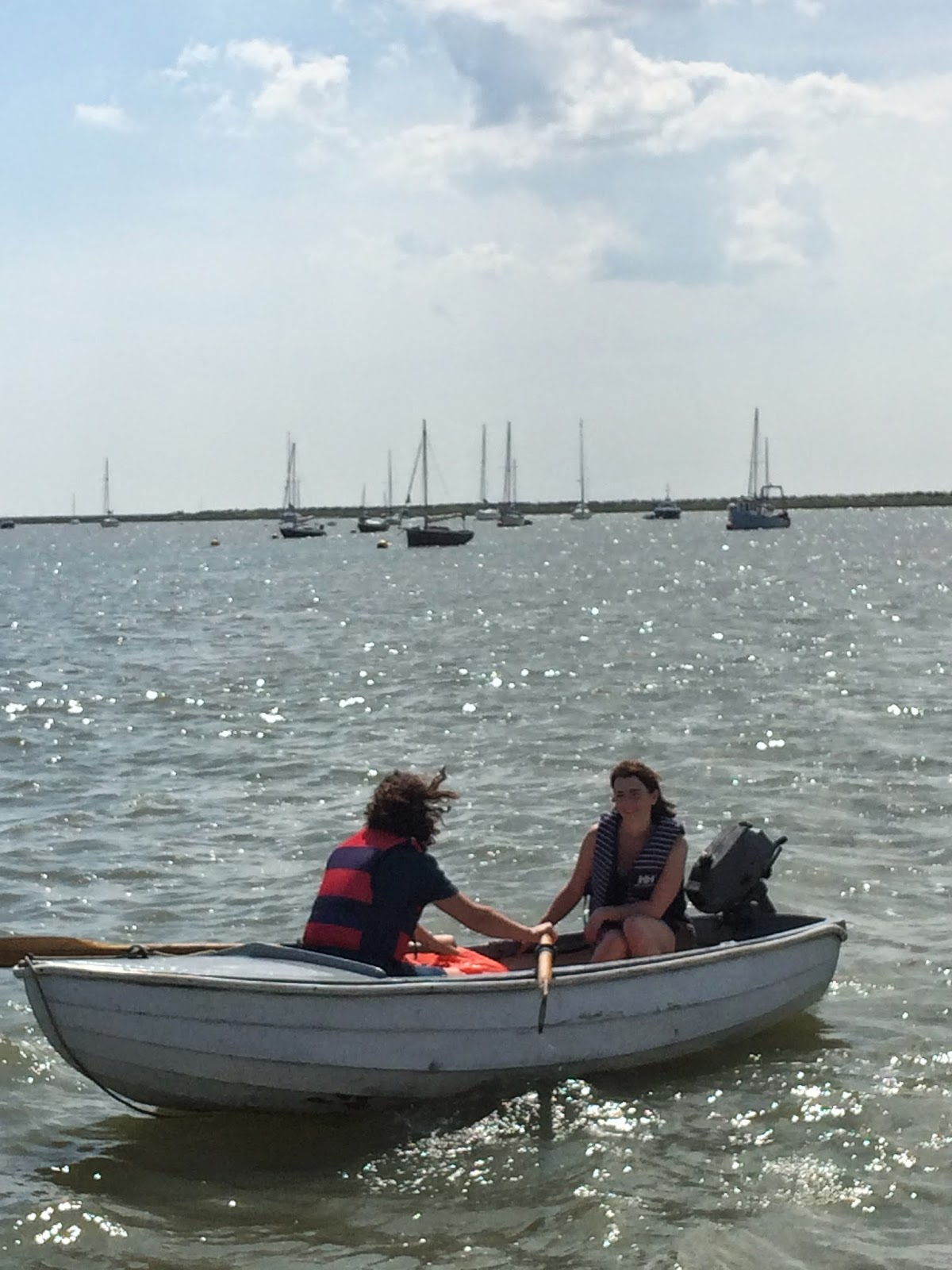 two women rowing small boat