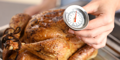 Food Safety Superhero Fighting Food-borne illness and food poisoning prevention - How to use a food thermometer for a safe cooking Temperature