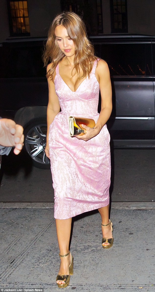 Jessica Alba arrives for a party in a low-cut dress in NYC