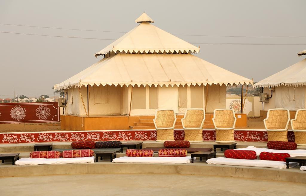 BHAVYA RESORTS JAISALMER - With garden views, Bhavya Resorts is situated in Jaisalmer and has a restaurant, a 24-hour front desk, bar, garden and children's playground. Both WiFi and private parking are accessible at the tented camp free of charge.  Featuring a balcony, each unit is air conditioned and features a dining area and a seating area with a cable flat-screen TV. There is a private bathroom with shower in all units, along with a hairdryer and free toiletries.  Bhavya Resorts offers a continental or buffet breakfast.  Guests can also relax in the shared lounge area.  Kuldhara Village is 39 km from the accommodation. The nearest airport is Jaisalmer, 72 km from Bhavya Resorts, and the property offers a paid airport shuttle service. CALL US ON 8000999660, 9427703236 FOR BEST RATES, JAISALMER TENT, JAISALMER HOTEL, JAISALMER RESORT, JAISALMER FLIGHT PACKAGE, JAISALMER RAILWAY TICKET, JAISALMER HOTEL PACKAGES, JAISALMER CAMEL RIDE, JAISALMER DESERT PACKAGE, JAISALMER TOUR BOOKING, WWW.AKSHARONLINE.COM, WWW.AKSHARONLINE.IN