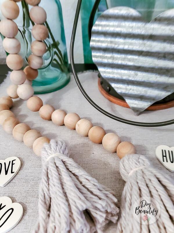 wood bead garland with fluffy tassels