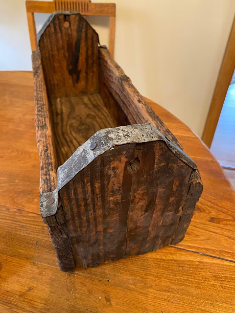 Photo of a rustic wooden toolbox