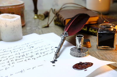 Quill, ink pot, and hand-writing