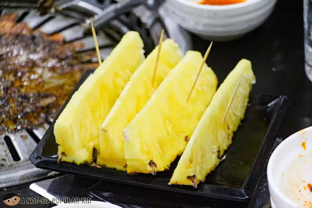 Free desserts in Korean Village Restaurant - huge pineapple slices