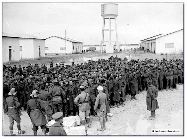 British POW in North Africa covered by Italian soldiers. December 1941. The prisoners were captured during the advance of Italian troops in Cyrenaica during the battle at Bir el Gubi