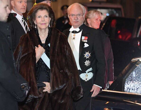Queen Silvia and Prince Daniel. Crown Princess Victoria wore Filippa K faux fur jacket. burgundy. red velvet dress. Princess Madeleine