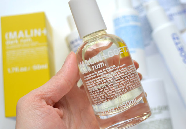 close up of malin and goetz eau de parfum dark rum bottle