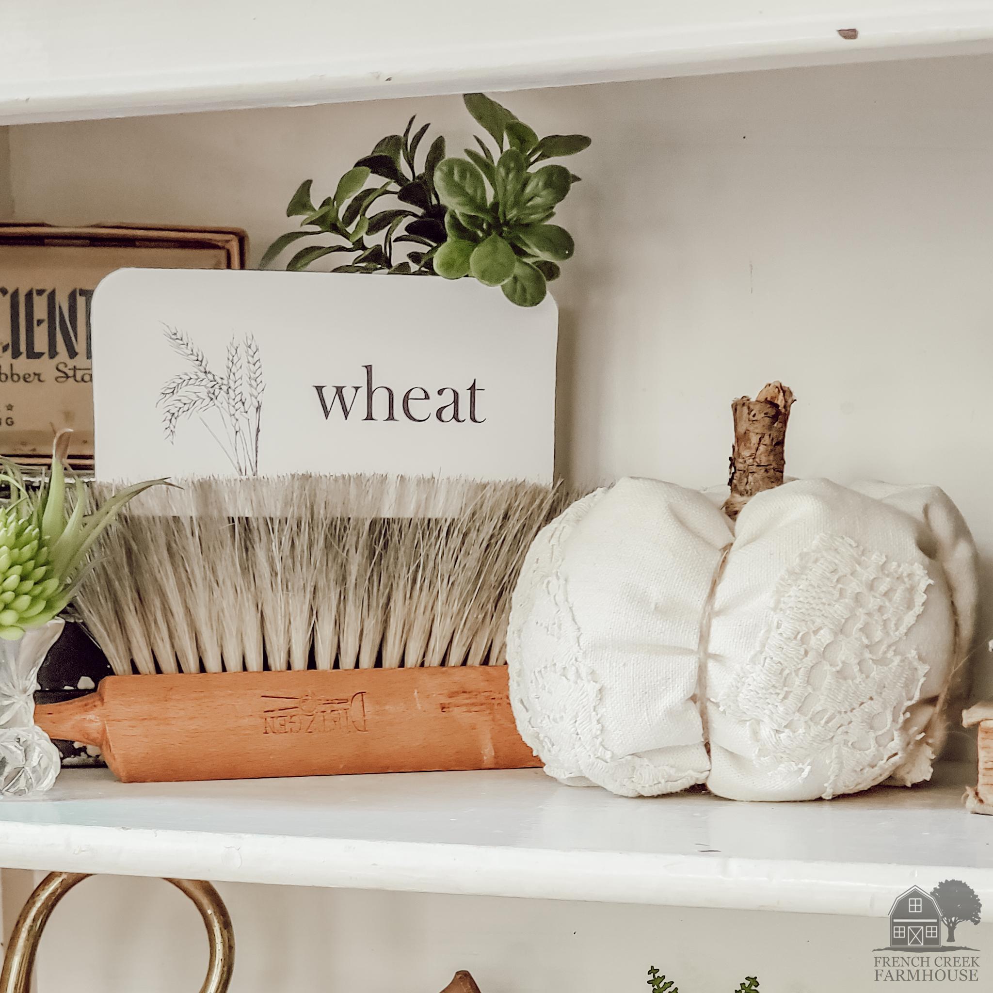 DIY fabric pumpkin as fall farmhouse shelf decor