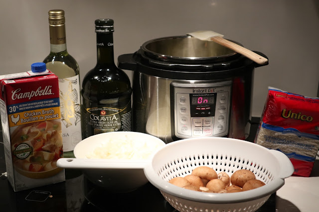 All the ingredients necessary to make pressure cooker risotto (chicken broth, Pinot Grigio White Wine, Olive Oil, Mushrooms, Arborio Rice, Chopped Onions and Garlic)