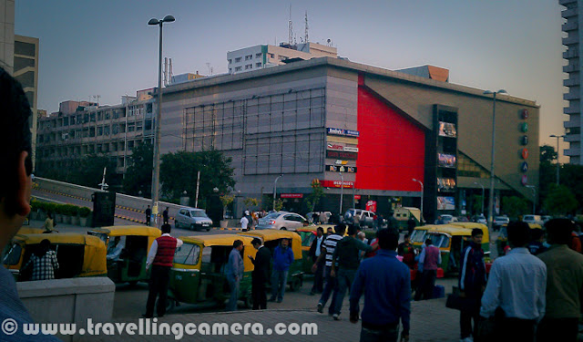 Although Nehru Place is mainly known for it's computer hardware market which is considered as largest one in Asia, but there are lot many other things to observce around this place. For now, let's have a quick Photo Journey with my HTC Desire HD and it's mainly focussed on Nehru Place Market and places visible from this part of the Delhi...-------------------------------------------------------------------------------The very first photograph of this Photo Journey shows a view of Iskon Temple which is visible from Metro Station. Nehru Place is well connected with Metro Train now, which starts from Centeral Scretriate.Here is first view after getting down from Metro Station at Nehru Place. Very Crowded places with some Autos lined up to take their clients to appropriate places, but on thier terms. Satyam Cinemas is just in front of Nehru Place Metro Station, as you can see in above Photograph. After crossing the road and Satyam Cinema, we enter into a huge Market-complex behind Satyam Cinema. This is extremely fast moving region, where everyone is rushing towards various Computer Hardware shops to check out different products with respect to specifications, cost, new technologies etcHere is typical view of Nehru Place Market where it's surrounded by multi-storey buildings from all sides. All these floors have various Computer Hardware dealers, shops and assembling service providers. In fact, there are some of the very large scale dealers for various branded computers and other equipments like Printers, Scanners, Extrenal Hard Disks etc.There is very strong network of dealers in this market, which ensures that no one is cutting much on the rates to avoid overall loss of this market. Their benefit is always in ensuring standard ranges for different types of computer components. Although customer may get higher prices, as many of them come to this market without proper home-work around the prices & configurations. I have seen many people going to this market with an impression that they get good stuff at cheaper rates and end up with cheaper rates for old configurations...There are some of the shops at Nehru Place Computer hardware Market where rate lists with appropriate specifications are pasted and you have to just order the component you want. No scope of negociations and success rate of such shops is seen much more than other dealers. As of now, I am forgetting the name of a dealer who is very popular for fixed priced computer components and located on first floor.Here is one of the sample from fixed priced shop at Nehru Place computer hardware market in national capital region of India - Delhi !!!Apart from Computer Hardware other stuff like cloths, shoes etc are also sold on the streets of Nehru Place Market. All this stuff is non-branded and most of the times low quality. But some of the use & throw electronic stuff is quite cheap in this marketApart from main computer shops and street shops, few boys can be seen roaming around this place. They sell pirated Softwares for 50 Rs to 200 Rs, depending upon the kind of software you want. At times, you can get a good deal of having 4-5 softwares in 100 rupees. Latest versions of almost all the softwares can be seen in this market. Everyone knows about this fact including government.There are some of the eating points around this place and people spend complete day in searching for right stuff. Many folks for surrounding states come to this market to buy Computer Components in whole-sale and book profits in their local regions.With all these basic details about Nehru place market, it was time to leave the place and move towards our homes. Sunset was beutiful on that day and we were missing our cameras at this point of time, but still HTC Desire helped in capturing these moments for usNehru Place market is surrounded by some of the other intersting places like Bahai's Temple (Lotus Temple) and Iskon Temple. Lotus temple is one of the main tourist places in Delhi, India and Iskon Temple is a paradise for peace lovers. It's exactly in Kailash Coloy from where Lotus temple is also clearly visible. There are some light and sound shows at this temple, which are mainly around stories of Radhe Krishna