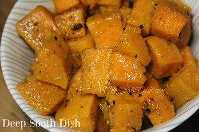 A sweet potato salad, made with roasted sweet potatoes and marinated in an olive oil, apple cider and honey vinaigrette dressing.