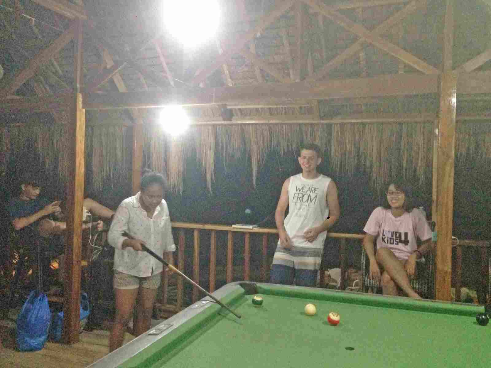 budget cheap resort in panglao white island bohol philippines in 2018, best travel summer vacation tour, panglao chocolate hills resort billiard area, picture taking while playing billiard
