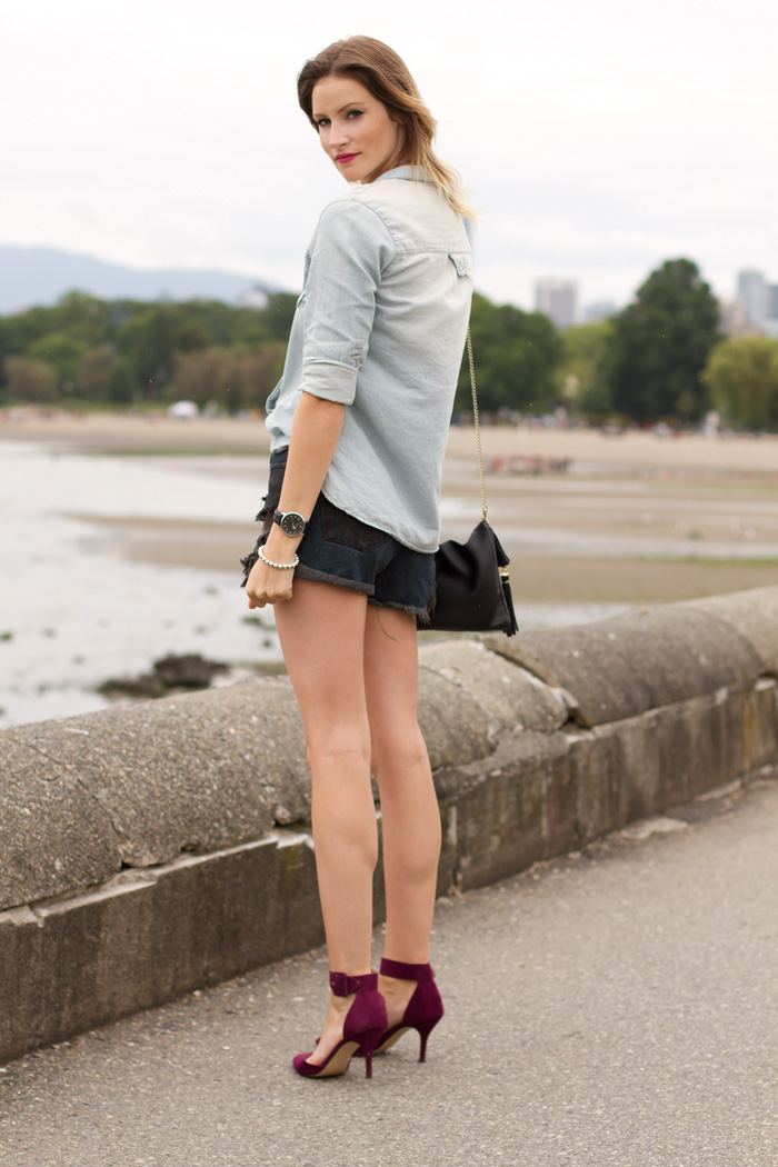 Vancouver Fashion Blogger, Alison Hutchinson, wearing One Teaspoon Hawks denim cut off shorts in black and blue, Urban Outfitters Chambray Top, Zara burgundy ankle strap pumps, Tiffany, La Dama and Pyrrha Necklaces, Stella & Dot and True Worth Design Bracelets, H&M black leather bag