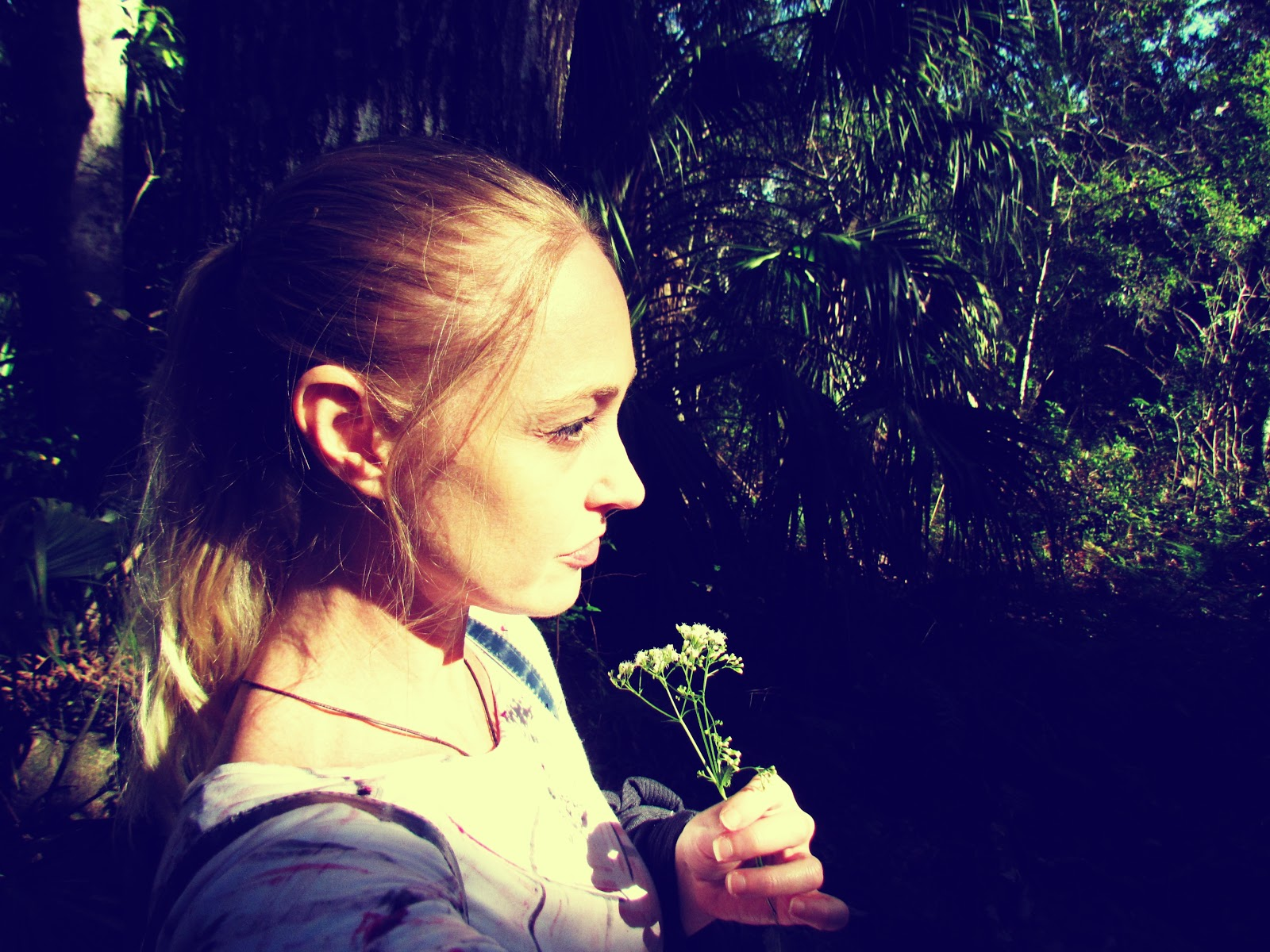 A woman with a ponytail walking on a trail in tropical Florida with self portrait