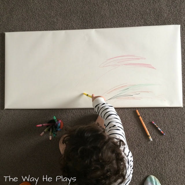 Toddler drawing on large scale paper