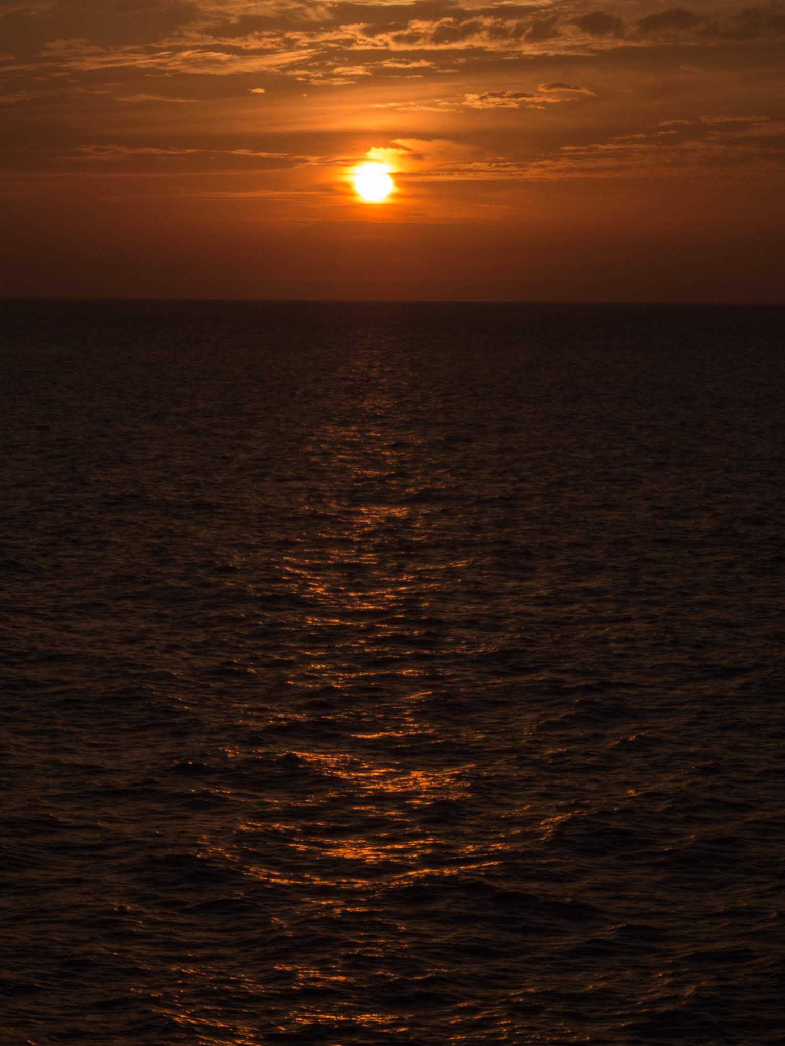 Sun setting on the Atlantic Ocean in October.