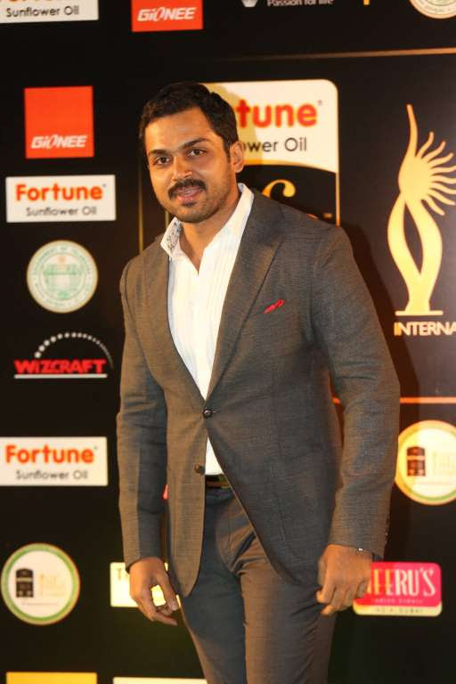 Tamil actor Karthi poses for photographers upon arrival at IIFA Utsavam