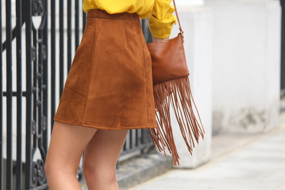 peexo fashion blogger wearing suede skirt and snake print ankle boots