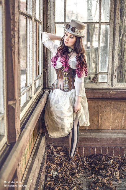 Women's steampunk clothing for fashion inspiration: white dress, corset, tights, top hat and goggles.