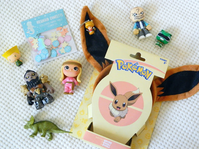 A selection of toys from the Toys for a Pound website, funko figures, eevee ears headband, dinosaur figure