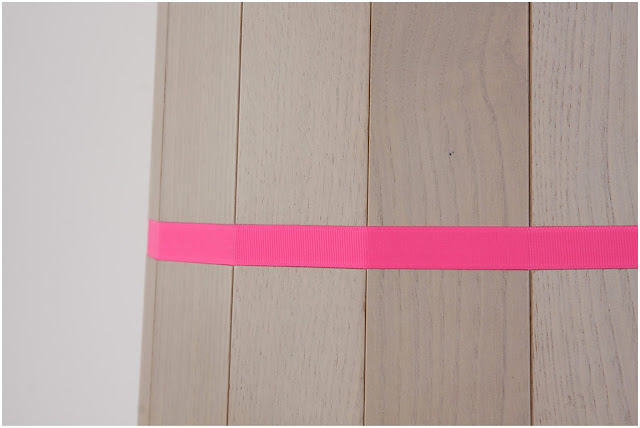 Detail of pink stripe on Colour Wood side table designed by Scholten & Baijings for Karimoku New Standard
