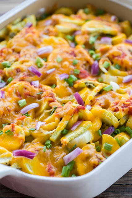 Southwestern Squash Casserole - CRAZY good!!! Great side dish for all your tex-mex dishes!! Squash, cheddar cheese, onion, green chiles, jalapeños, cumin, salsa, green onions, red onion. Everyone loved this easy side dish recipe. Great for a potluck and cookout.