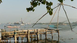 Chinese nets at Fort Vypin with Bharat ferry boat in background