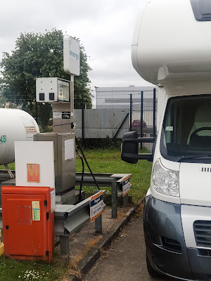 On the left is a rather ancient looking filling point with various tanks around it. On the right is our motorhome.