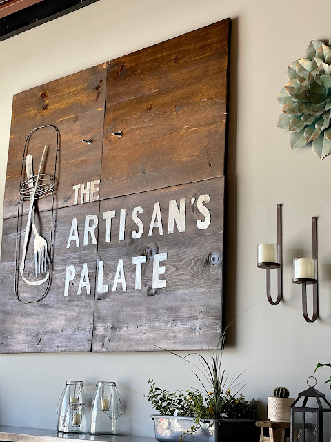 Signage from The Artisan's Palate Restaurant