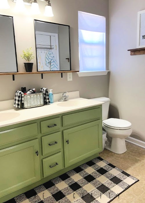 Bathroom Makeover on a budget  |  paint bathroom cabinets Brisk Olive by Valspar, paint walls with leftover paint, make shelf to hold mirrors, shelf above vanity
