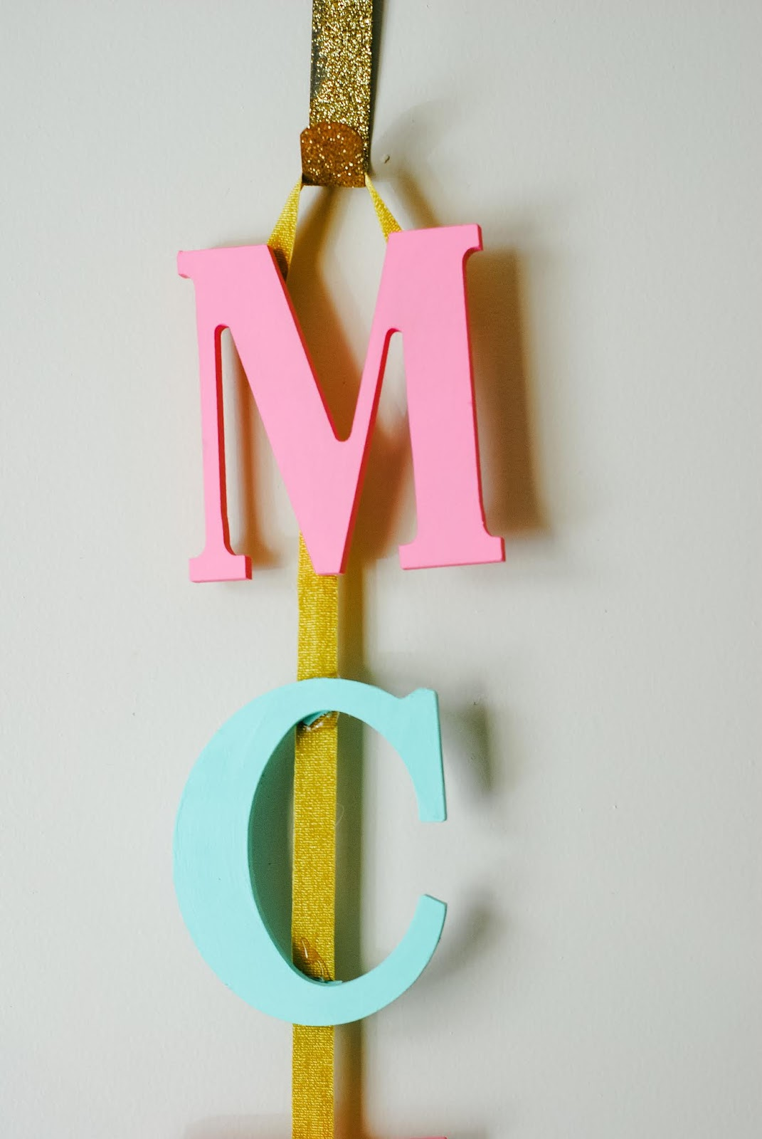 When I found out I was pregnant I could not wait to start turning our second bedroom into a nursery. When we found out it was a girl and decided on a name, I had so many ideas about themes and it was so hard to decide on decor. But I knew I wanted to make a few things by hand and always make them a part of McKenna's room. I love every single one of these DIYs and I'm so happy to share them on the blog with you today! Keep reading for 3 easy and inexpensive DIYs that will add a personalized touch to your little bundle of joy's nursery without breaking the bank! #babynursery #babygirlnursery #babynurserydiys #girlnurserydiy