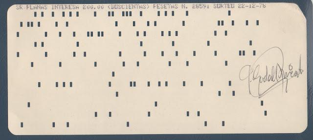Participació de loteria de nadal feta amb una fitxa perforada de 80 columnes