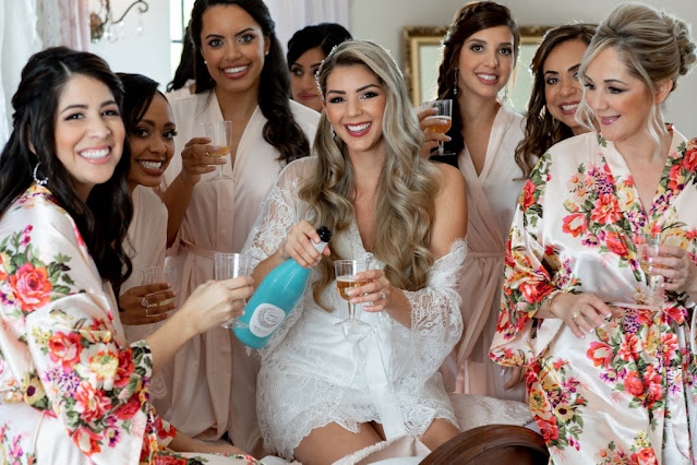 bridesmaids flower robes with champagne