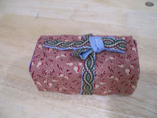 """Victorian rolled sewing kit, closed, from Anna Bauersmith's """"Fanciful Utility""""."""