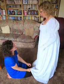 Rachel having a fitting of her Regency dress