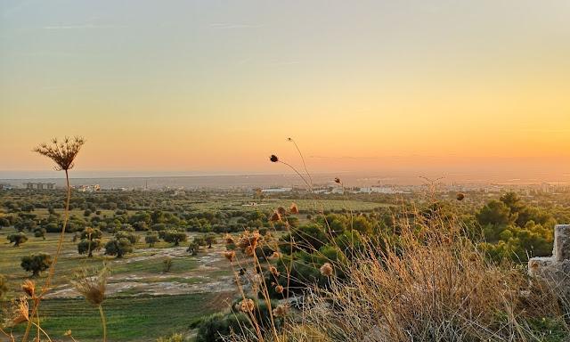 Tramonto arancione sulla piana Massafra