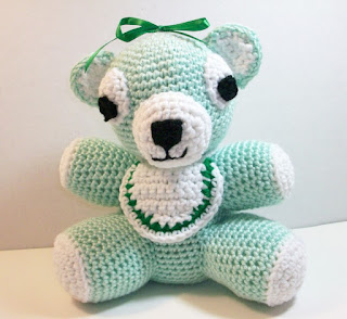 plush baby bear in pastel green