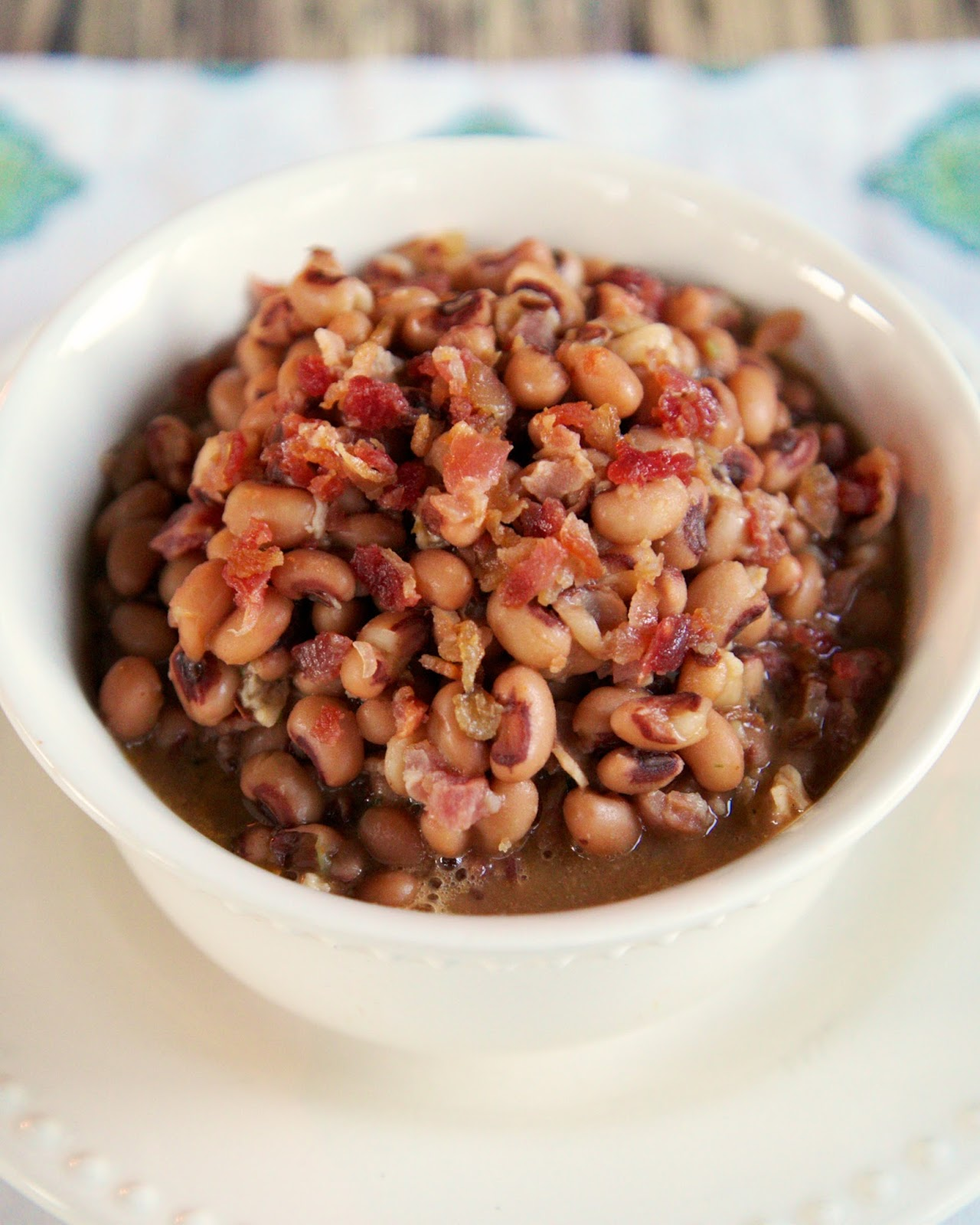 Cajun Black-Eyed Peas Recipe - bacon, black-eyed peas, chicken broth, hot sauce and cajun seasoning - great way to doctor up canned black-eyed peas!