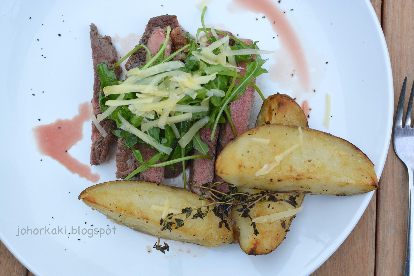 Beef tagliata (Italian sliced steak) with arugula (rocket), thyme, G ...