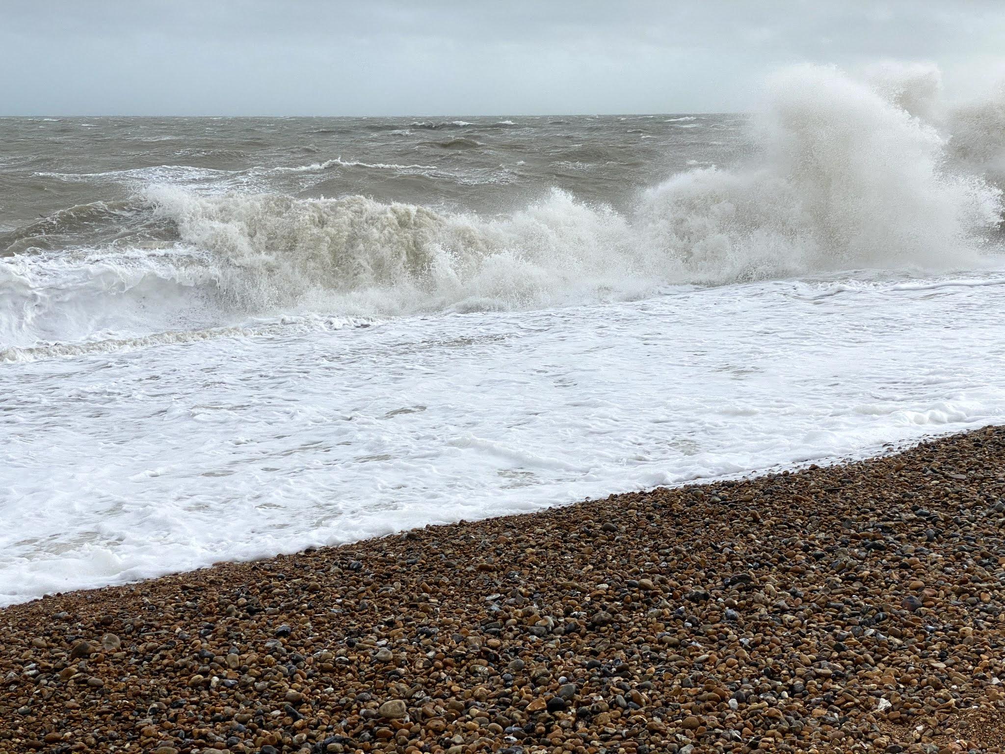 Waves crashing on a stony beach