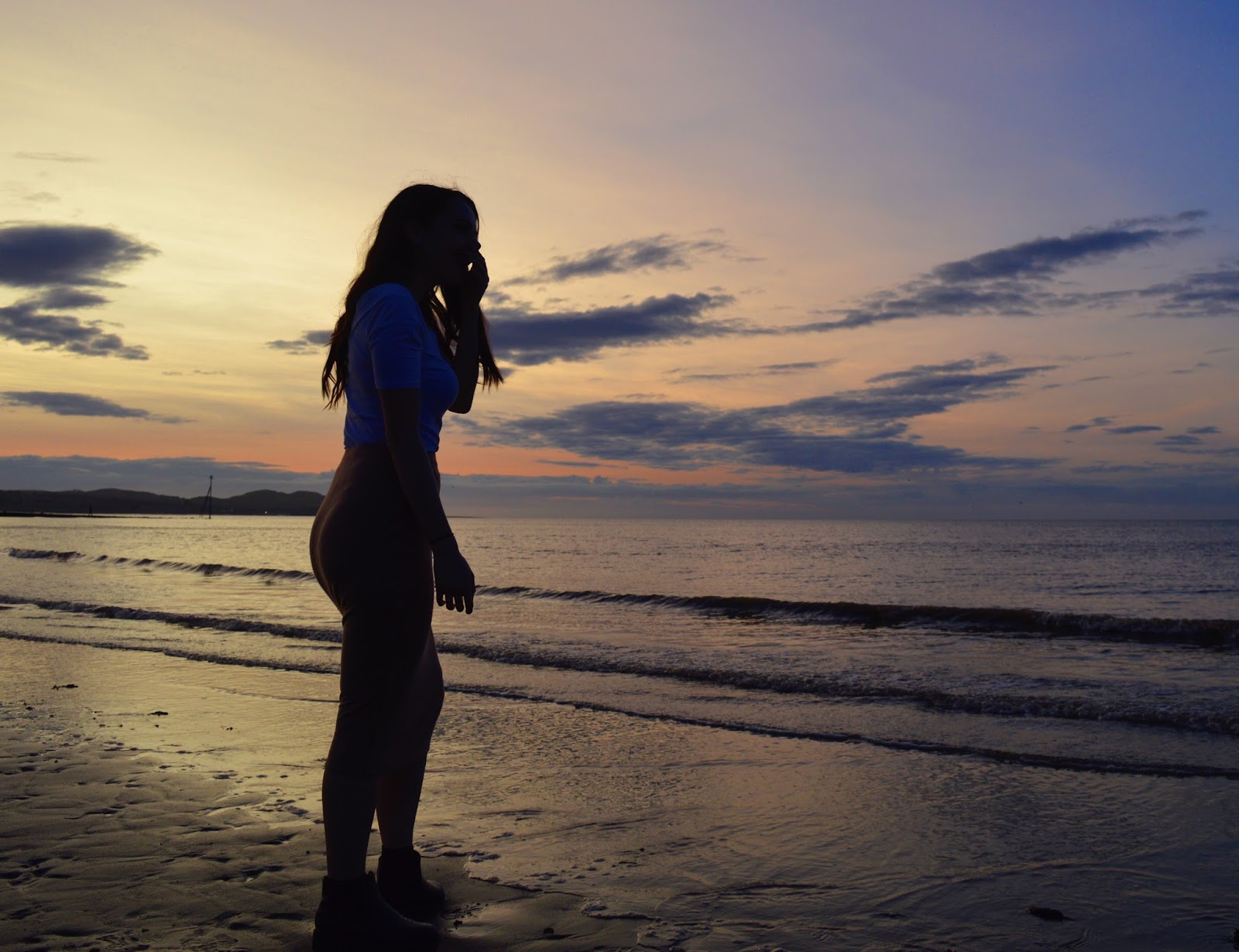 girl in front of sunset, wales