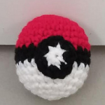 http://www.ravelry.com/patterns/library/small-pokeball-2