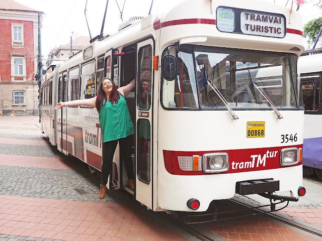 Plus size travel blogger The Owlet on a tourist tram in Timisoara, Romania