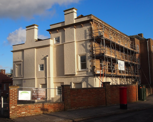 A photo of the former Unison House on The Crescent, Taunton, Somerset. It has scaffolding around the building.