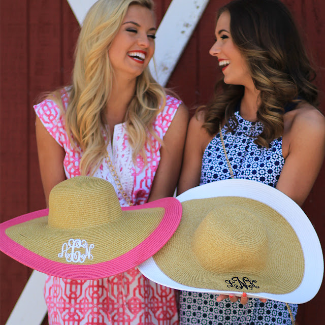 girls laughing wear pink and white sun hats