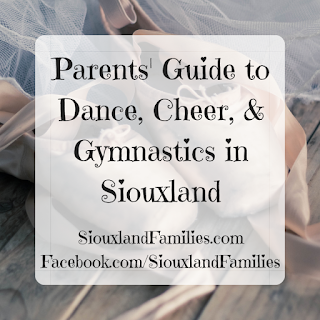 """in background, some pale pink ballet pointe shoes and ribbons sit on a wooden floor next to a white tulle skirt. in foreground, the words """"parents guide to dance, cheer and gymnastics in Siouxland"""" and """"SiouxlandFamilies.com Facebook.com/SiouxlandFamilies"""""""