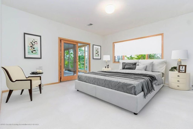 The master bedroom in this Lainsburg, Michigan home opens to an Endless Pools sunroom.